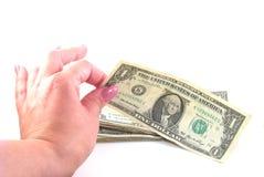 Hembra que toma el dólar Fotografía de archivo libre de regalías