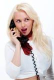 Hembra rubia bastante joven en el teléfono viejo Imágenes de archivo libres de regalías
