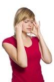 Hembra rubia que tiene un dolor de cabeza imagen de archivo