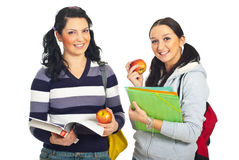 Hembras bonitas de los estudiantes que sostienen manzanas Imagen de archivo libre de regalías
