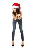 Hemdloser tragender Weihnachtsmann-Hut der Frau Lizenzfreies Stockfoto