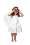 Hemelse engel die lettend op door verrekijkers kijkt stock foto's