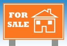 hemförsäljningtecken Arkivfoto