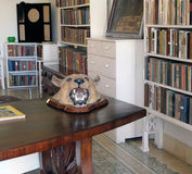 Hemingway's Home in Cuba. A glimpse into Hemingway's Home in Havana, Cuba with his favorite  books and stuffed animals Stock Photo