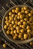 Hemlagade kryddiga rimmade bakade kikärtar Royaltyfri Bild