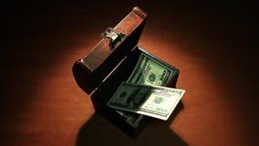 Hemlig vinst Mycket pengar 100 sedeldollar arkivfilmer