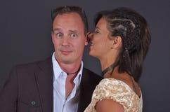 hemlighet för par s Fotografering för Bildbyråer