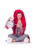 Hemmafru med klockan Arkivbild