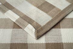 Hemmed edge of fabric closeup Stock Images