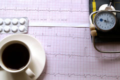 Hemopiezometer for measuring blood pressure, cup of coffee, pill Stock Photo