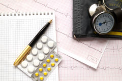 Hemopiezometer for measuring blood pressure,  pills and ECG test Royalty Free Stock Photos