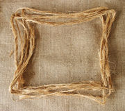 Hemp border on burlap Stock Images