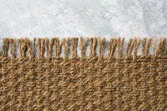 Hemp carpet on Cement floor. Sisal background or wallpaper. Royalty Free Stock Image