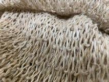 Hemp fibers woven into a piece, lightbrown natural fiber bundle texture and background. Hemp eco fibers woven into a piece, lightbrown natural fiber bundle stock photos