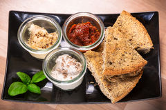 Hemp flour bread with dips Royalty Free Stock Photo