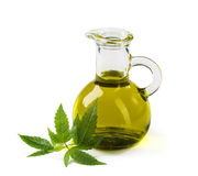 Hemp oil n a glass jar stock photos