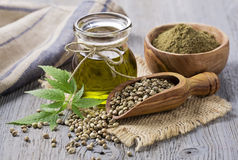 Hemp oil n a glass jar. And hemp seeds stock images