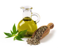 Hemp oil n a glass jar. On a white background stock photo