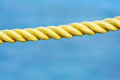 Hemp rope. At maldives landing stage handrail royalty free stock photography