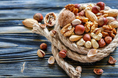 Hemp rope and a mixed of nuts. Stock Images