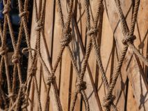 Hemp rope. Net covers wooden crate Royalty Free Stock Photos