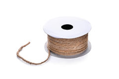 Hemp rope in paper roll isolated on white background. Hemp rope in paper roll isolated on white Royalty Free Stock Photography