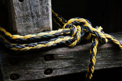 Hemp rope. Picture of hemp rope tied in a pier post Stock Images