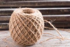 Hemp rope on wood background Royalty Free Stock Photos