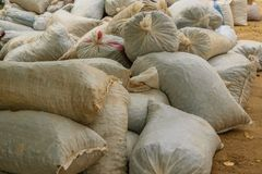 Hemp sacks full of harvest products accumulated on the ground. Agriculture, business concept Royalty Free Stock Photography