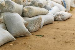 Hemp sacks full of harvest products accumulated on the ground. Agriculture, business concept Royalty Free Stock Photo
