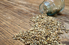 Hemp seed on table with jar royalty free stock photography