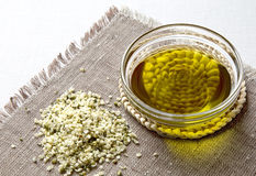 Hemp seeds and hemp oil. Healthy choice. Hemp seeds and hemp oil in the glass bowl Stock Photography