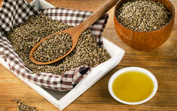 Hemp seeds and oil on wooden background. Stock Photography