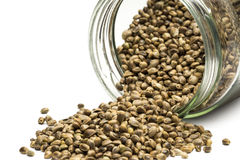 Hemp seeds in an overturned glass jar Stock Image