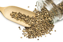 Hemp seeds in an overturned glass jar Royalty Free Stock Images