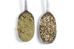 Hemp seeds and powder. On white Royalty Free Stock Photo