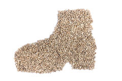 Hemp seeds in shape of man's shoe Royalty Free Stock Photos