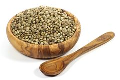 Hemp seeds. Wooden bowl with hemp seeds isolated on white background Royalty Free Stock Photo