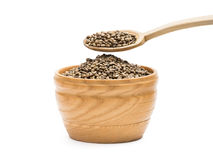 Hemp seeds in a wooden bowl Royalty Free Stock Photography