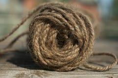Hemp Yarn. A roll of yarn on an aged wooden table Stock Photos