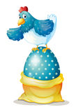 A hen above a big easter egg� Royalty Free Stock Photo