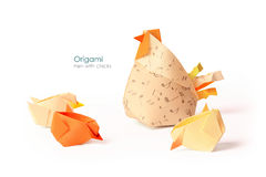 Hen with chicks. Care hen with chicks origami on white background Stock Photos