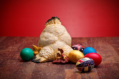Hen With Colored Eggs Stock Photo