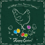 Hen and easter colored eggs on green background Stock Photo