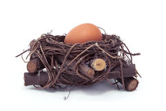Hen egg in a nest. Isolated Stock Photos