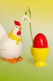 Hen and egg with snowdrop Stock Image