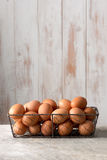 Hen Eggs in Chicken Wire Tray with Copy Space. Bunch of brown hen eggs in chicken wire tray with copy space stock photo