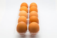 Hen eggs in container Stock Images