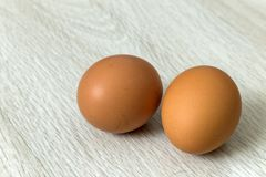 Hen eggs on kitchen table background. Healthy organic food, delicious meal, cholesterol and diet concept.  stock image