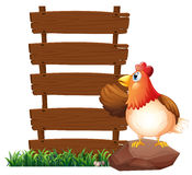 A hen beside the empty signboards Royalty Free Stock Image